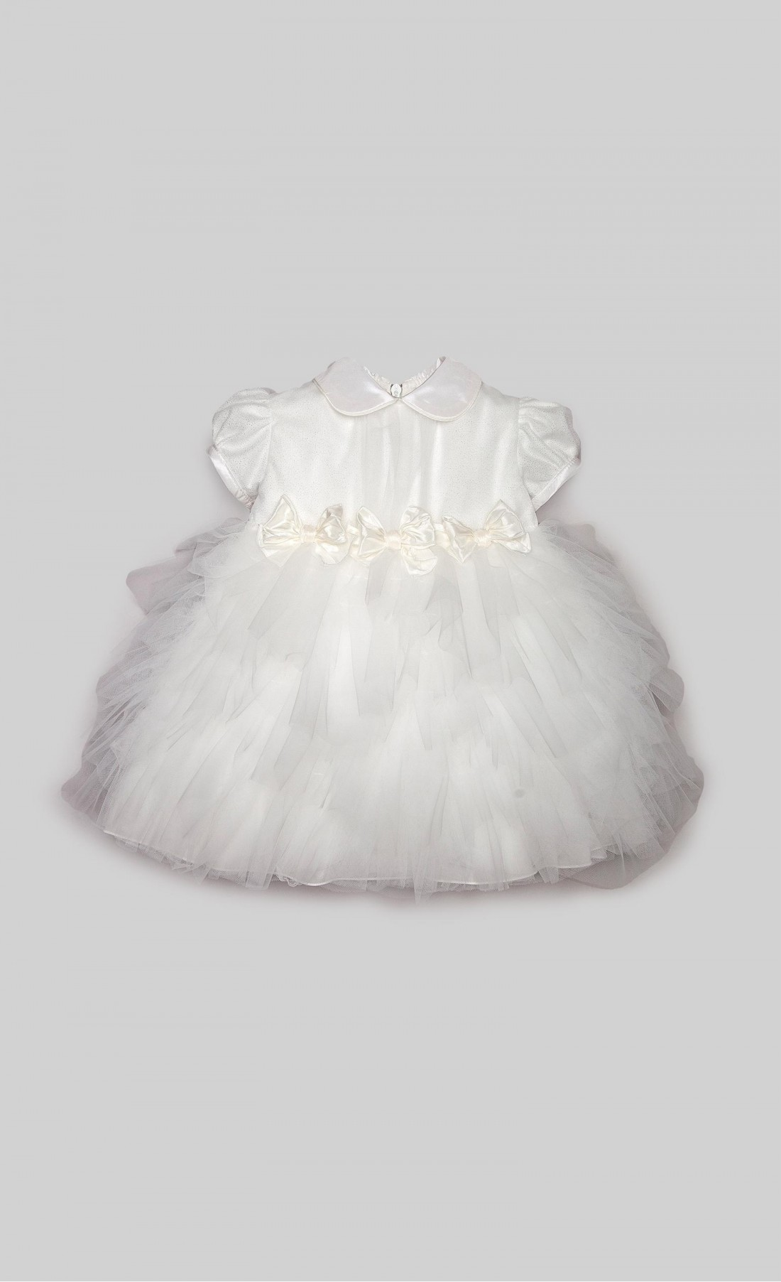 Cream dress in lurex tulle with bows